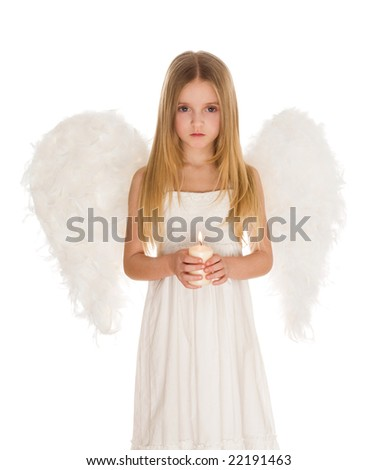 Portrait of girl in angelic costume holding candle - stock photo