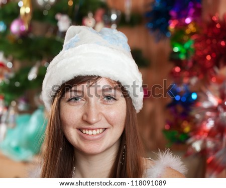 portrait of girl in blue Christmas hat - stock photo