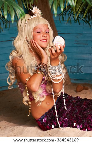Portrait of girl in costume a mermaid - stock photo
