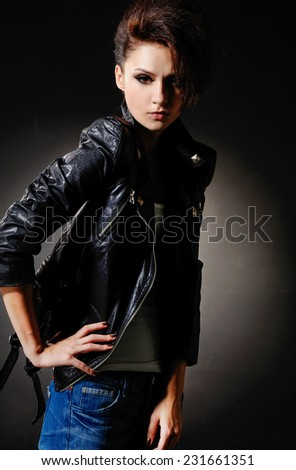 Portrait of girl in jeans posing on light background - stock photo