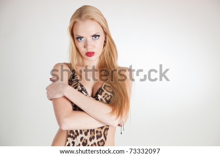 Portrait of girl in leopard dress, studio isolated shot
