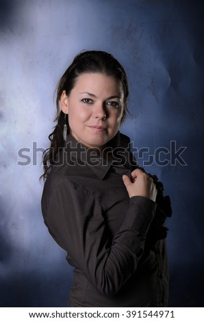 Portrait of girl in Studio on metal background. Girl in bright blouse