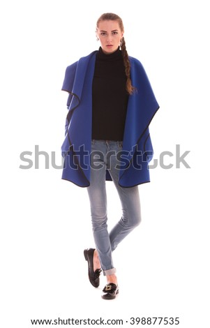 Portrait of girl in Studio on white background. Fashion coat.