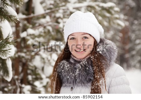 Portrait of  girl in wintry pine  forest - stock photo