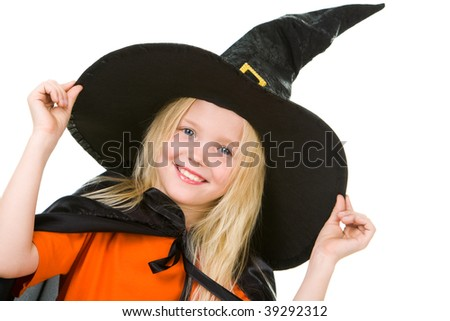 Portrait of girl in witch costume posing before camera