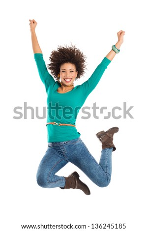 Portrait Of Girl Jumping In Joy Isolated Over White Background - stock photo