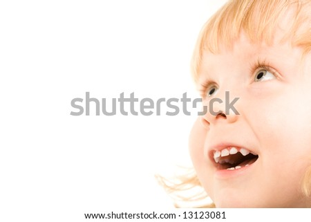 Portrait of girl looking at something with amazement - stock photo