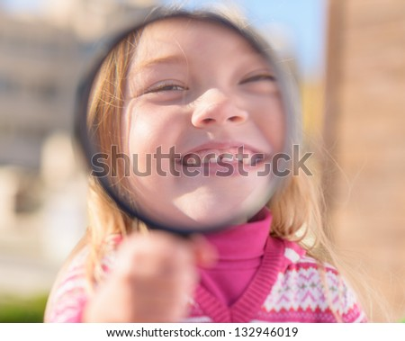 Portrait Of Girl Looking Through Magnifying Glass, Outdoors