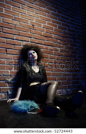 portrait of girl  near brick wall - stock photo