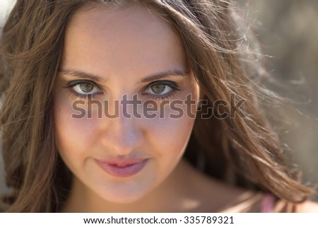 Portrait of girl on open air. Young woman looking at camera, close-up