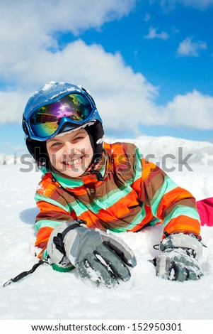 Portrait of girl on skis in soft snow on a sunny day in the mountains - stock photo
