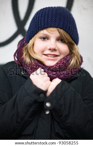Portrait of girl outside in the winter - stock photo