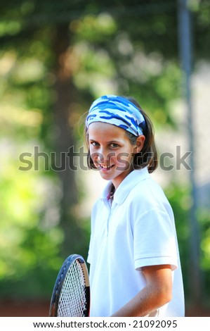 portrait of girl playing tennis - stock photo