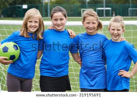 Portrait Of Girl's Soccer Team - stock photo