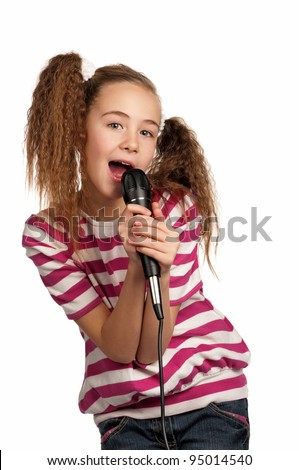 Portrait of girl singing with microphone isolated on white background - stock photo