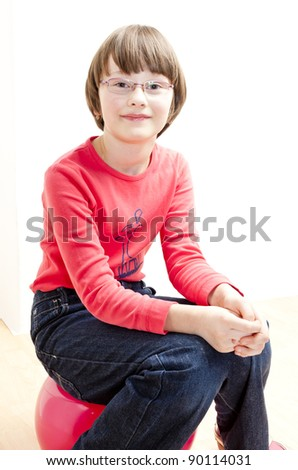 portrait of girl sitting on a ball - stock photo