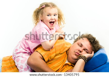 Portrait of girl sitting on her daddy and screaming