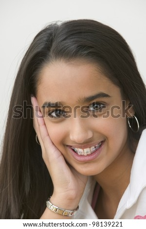 Portrait of girl smiling with braces - stock photo