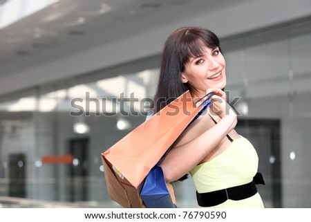 Portrait of girl standing in the mall after doing shopping