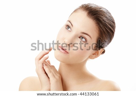 Portrait of girl touching the well-groomed face, isolated on a white background - stock photo