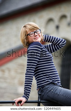 Portrait of girl wearing fashionable eyeglasses with retro frames - stock photo