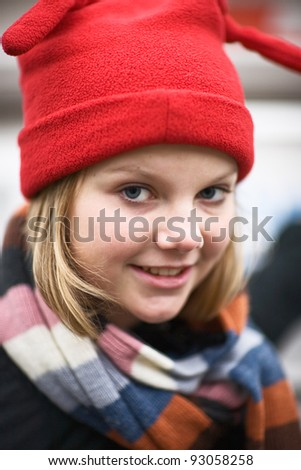Portrait of girl wearing red knit hat - stock photo