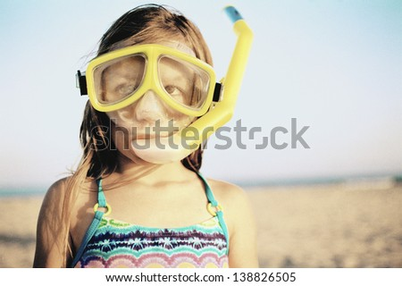 Portrait of girl wearing snorkeling gear