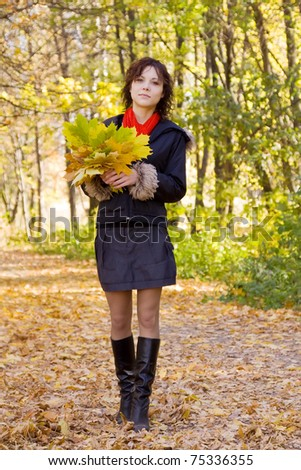 portrait of girl with autumn bouquet in park - stock photo