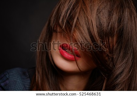 portrait of girl with beautiful lips and with hair covering her face, the concept of health, fashion