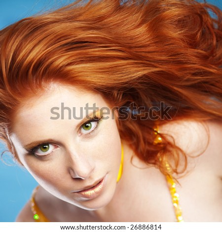 Portrait of girl with beautiful red hair ob blue - stock photo