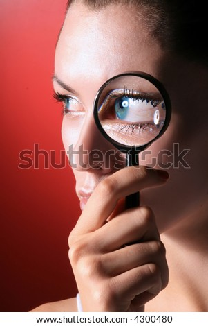 portrait of girl with blue eyes on magnifier
