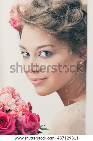 portrait of girl with bouquet of flowers