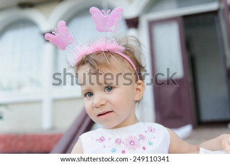portrait of girl with butterflies on headband - stock photo