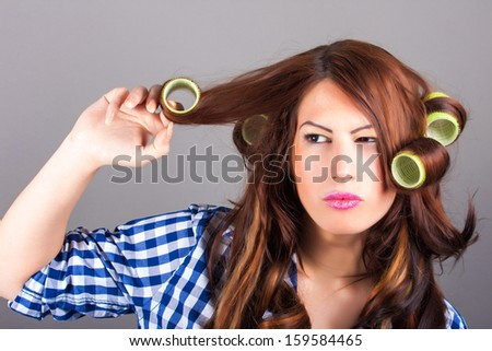 portrait of girl with curlers - stock photo