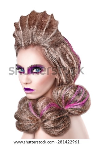 Portrait of girl with gorgeous makeup in violet colors, portrait mode with an unusual hairstyle. Subject seashell. - stock photo