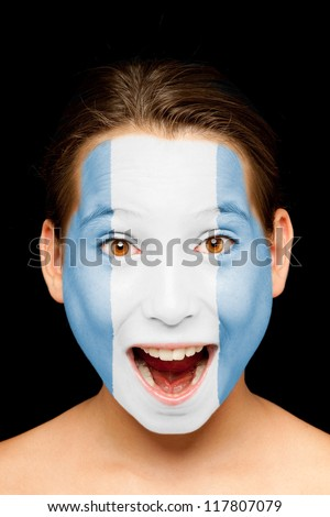 portrait of girl with guatemalan flag painted on her face - stock photo