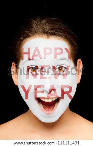 portrait of girl with happy new year  painted on her face - stock photo