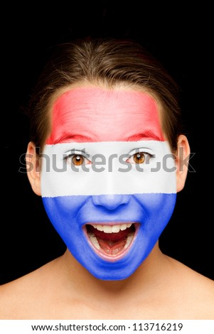 portrait of girl with Netherlands flag painted on her face - stock photo