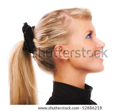 Portrait of girl with ponytail in profile, on white background.