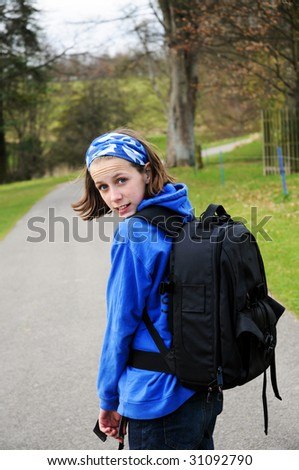 portrait of girl with rucksack - stock photo