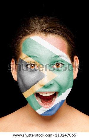 portrait of girl with south african flag painted on her face - stock photo