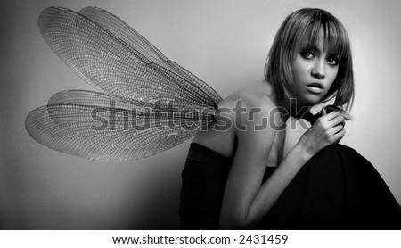 Portrait of girl with wings. Studio fashion photo. - stock photo