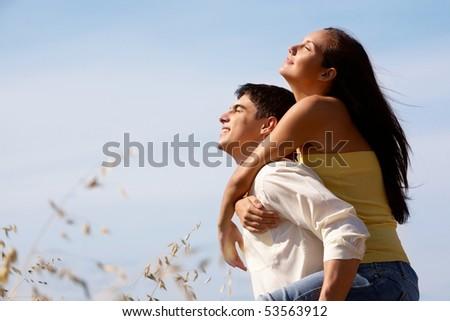 Portrait of girlfriend and boyfriend enjoying summer day outdoors - stock photo