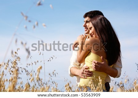Portrait of girlfriend and boyfriend hugging each other - stock photo
