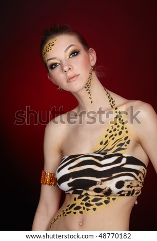 portrait of girll in cat make-up and bodyart