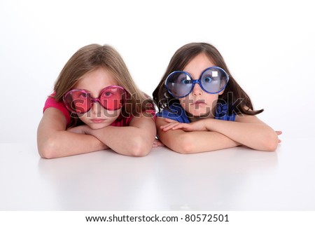 Portrait of girls doing funny faces - stock photo