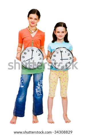 Portrait of girls holding clocks isolated over white - stock photo