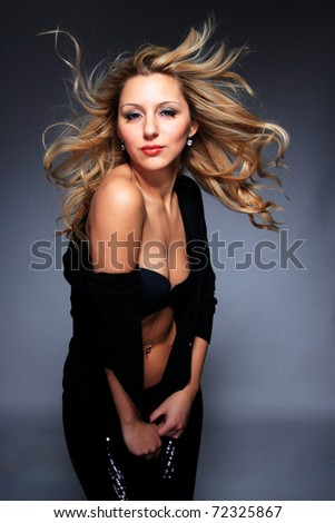 Portrait of glamor woman over dark gray background