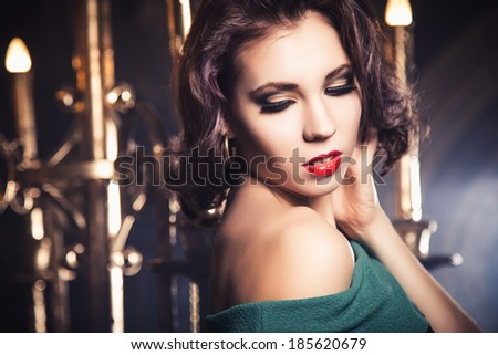 portrait of glamorous sexy young woman in interior