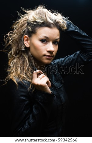 Portrait of glamour beautiful young woman - black background